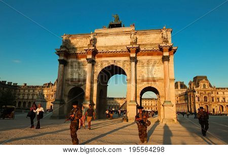 Paris, France - JUNE 23, 2017: The Arc de Triomphe du Carrousel is a triumphal arch in Paris, located in the Place du Carrousel.The military patrol on duty.