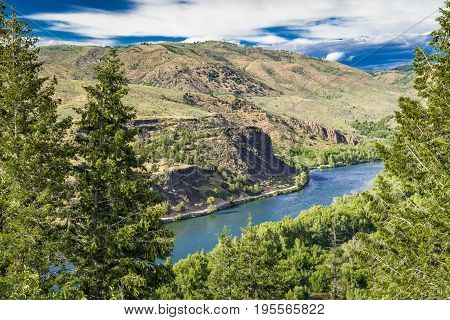 Snake River in Idaho with trees and mountains