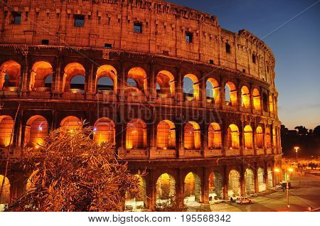 Rome Italy,November 5th 2010.Abstract image of one of the wonders of the world the Roman Colosseum in Rome lit up at nighttime.Ancient Roman architecture.