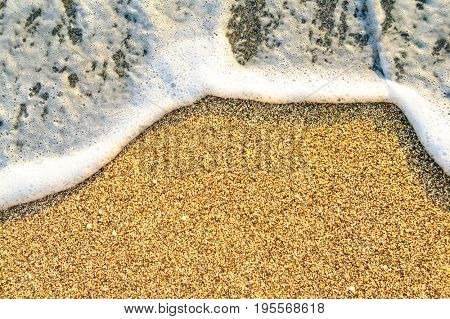 Summer Beach Background with Soft Sea Waves and Sand. Travel and Vacation Concept.