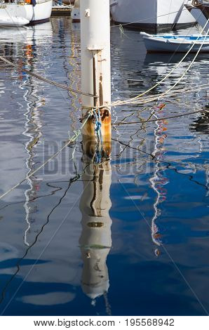 Reflections Of Boats And Mooring Lines