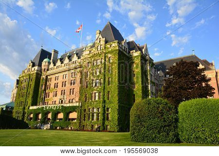Victoria BC,Canada,May 15th 2014.The iconic Empress hotel in Victoria BC,with its climbing ivy and manicured grounds is an awesome place to stay.Right across from the inner harbor,the Empress is centralized for all to see and enjoy.