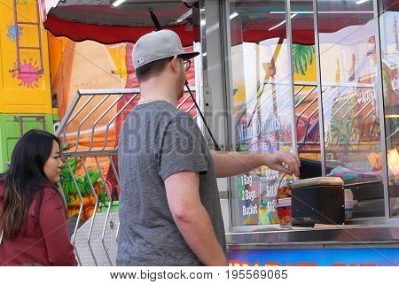 Coquitlam, BC, Canada - April 09, 2017 : People buying donuts at the West Coast Amusements Carnival