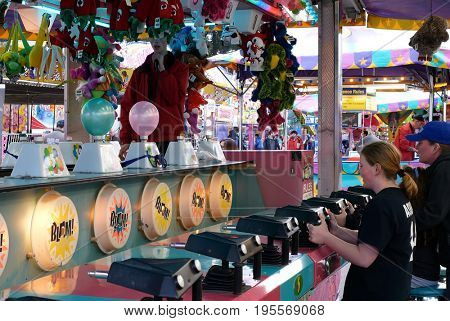 Coquitlam, BC, Canada - April 09, 2017 : Motion of children playing shotting carnival game in Coquitlam BC Canada