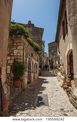 Baux-de-Provence, France - July 05, 2016. Ancient stone houses in alley, in the medieval hamlet of Baux-de-Provence. Bouches-du-Rhône department, Provence-Alpes-Côte d'Azur region, southeastern France