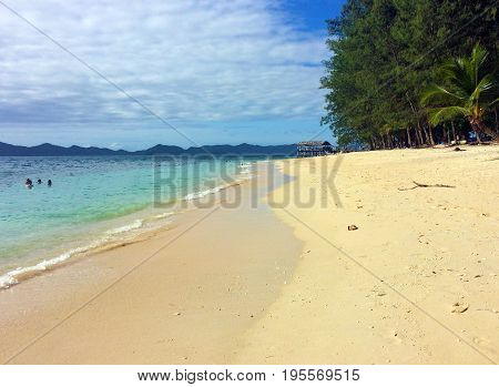 Beach Scene, Doini Island, Papua New Guinea.