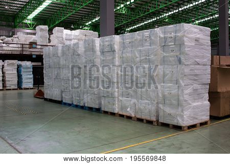 Foam keep of warehouse. Rows of shelves with boxes