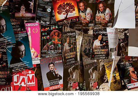 Avignon, France - July 06, 2016. Posters of theatrical pieces in Avignon Festival, an important performing art event happening in Avignon. Vaucluse department, region of Provence, southeast of France