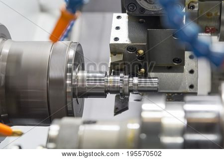 CNC lathe machine (Turning machine) cutting the aluminium screw thread shaft.Hi-precision CNC machining concept.