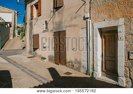 Châteauneuf-de-Gadagne, France - July 07, 2016. Traditional Provence houses on alley at sunrise, in Châteauneuf-de-Gadagne. Vaucluse department. Provence region, southeastern France. Retouched photo