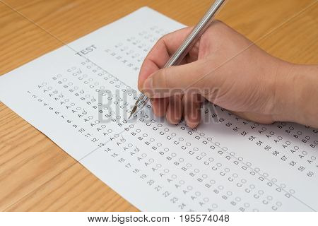 filling test score sheet with ballpoint horizontal composition