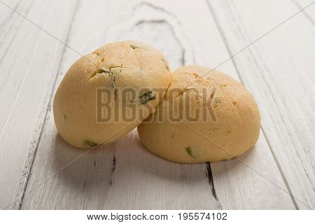 two buns on a wood table horizontal