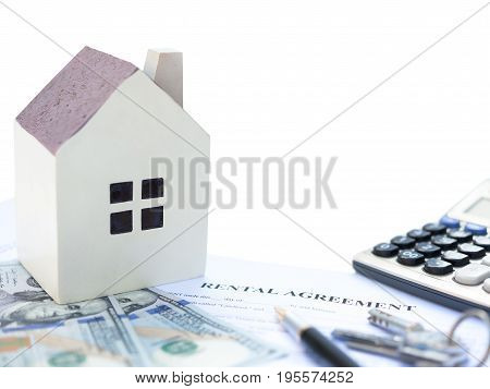 rental agreement contact with an architectural model and a calculator and pen and keys and USD dollars no logo or trademark clipping path included