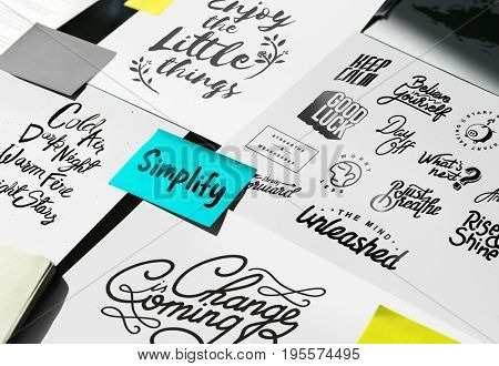 Paper Showing Simplify Word Artwork