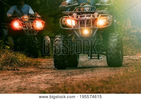 man riding atv vehicle on offroad track people outdoor sport activitiies theme