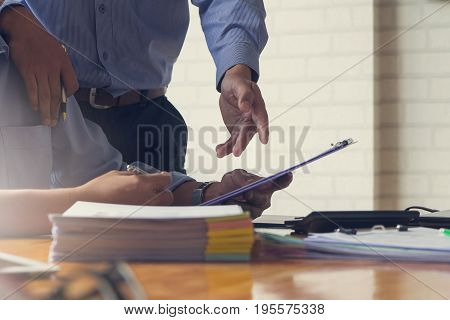 Business And Finance Concept Of Office Working, Businessmen Discussing Analysis Chart, Vintage Effec