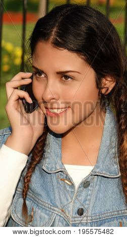 Beautiful Teen And Mobile Phone with Long Braided Hair