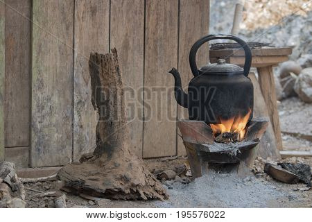 The kettle for gas is boiled on the brazier or pottery stove in the camp on the forest suitable for traveler to prepare fresh water or cook