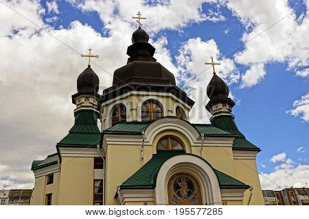 Beautiful christian temple with domes and crosses against the sky