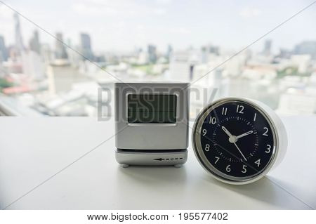 analog and digital modern clock on white table