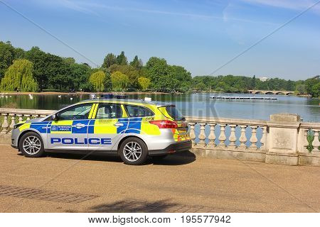LONDON, ENGLAND - May 24,2017: municipal police car on a background of Serpentine Lake, Hyde Park in London, UK
