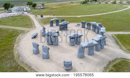 ALLIANCE, NE, USA - July 9, 2017:  Carhenge - famous car sculpture  created by Jim Reinders, a modern replica of  England's Stonehenge using old cars., aerial view