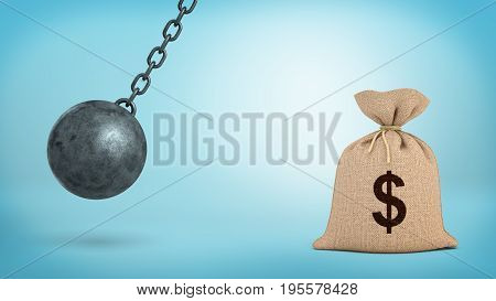 A large swinging wrecking ball on blue background beside a giant money bag with a USD sign. Money in danger. Banking insurance. Best saving plan.