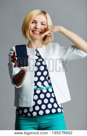 Woman with smartphone in hand