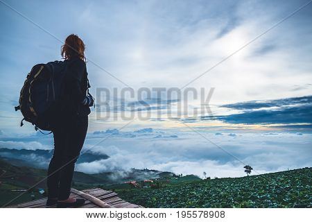 Asian women travel sleep relax. Morning atmosphere nature Forests mountains. Phu Thap Buek Thailand