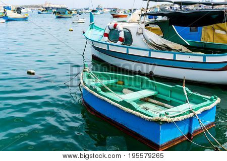 Traditional boats at Marsaxlokk Harbor in Malta