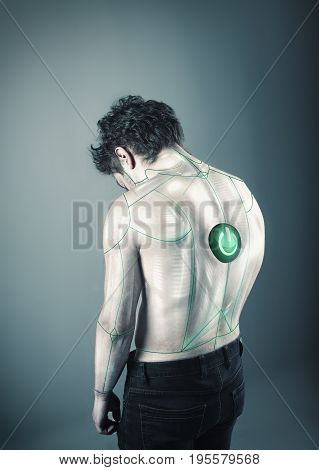 Image of a robot man turned off with a power button on his back.