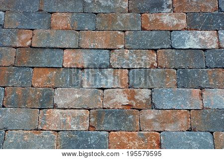Brown gray texture from the bricks of the house wall