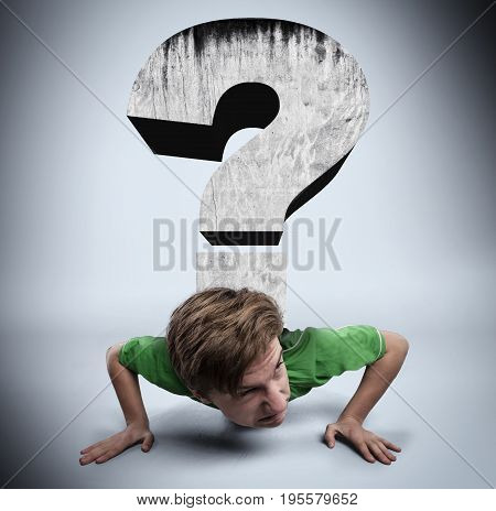 Young man is pushed by a question mark to ground.