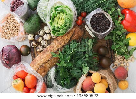 Set of healthy food. Cereals quinoa chickpeas beans bread various vegetables and fruits on a white wooden table top view