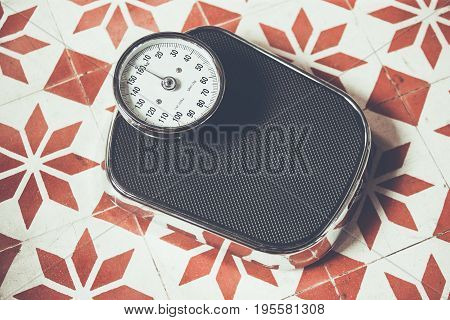 Classical vintage weighing machine on concreat background