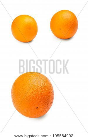 Three tropical and exotic, healthy oranges, isolated on a white background. An organic, fresh and bright orange vitamins. Ripe citrus fruits. The composition of the three ripe oranges. Citrus fruits.