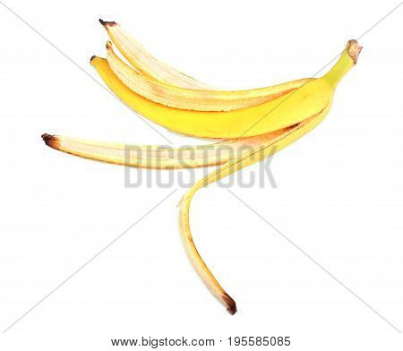 Banana skin, isolated on a white background. Bright yellow banana peel. Tropical fruits. Fresh banana skin. Ripe bananas.