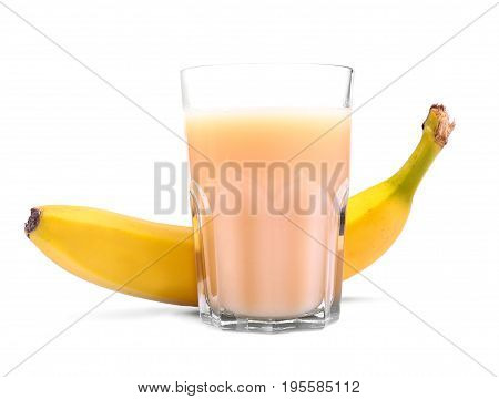 Fresh smoothie from sweet bananas. Healthy, summer cocktail from bananas. A huge glass full of banana juice or smoothie and next to it a fresh, ripe and yellow banana, isolated on a white background.