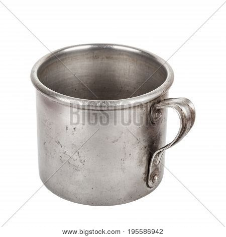 Old aluminum mug isolated on white background closeup