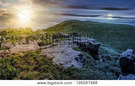 day and night time change concept. huge boulders on the edge of hillside. fine weather in summer mountain landscape