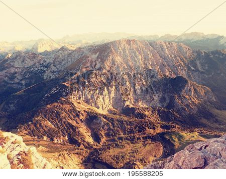 . Morning Sun Between Sharp Rocks,  Alpine  Cliff Above Valley. Daybreak Sun