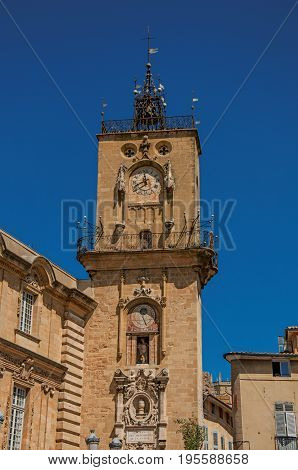 Close-up of clock tower with sunny blue sky in Aix-en-Provence, a pleasant and lively town in the French countryside. Located in Bouches-du-Rhone department, Provence region, southeastern France