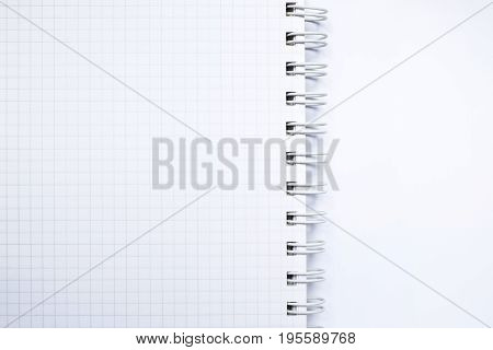 Close up top view of white ring binder notebook.