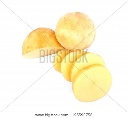 Perfectly chopped fresh potatoes isolated on a bright white background. A whole peeled yellow potato. Delicious vegetables full of starch. Vegetarian lifestyle.