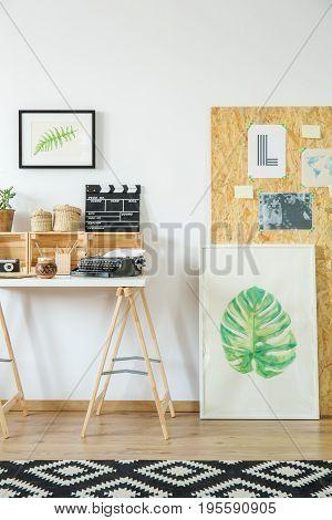 Artist's Workspace With Wooden Furniture