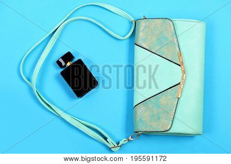 Fashion And Glamour Concept. Purse In Light Turquoise Color