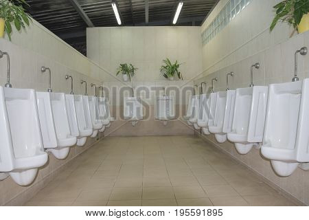 contemporary interior of public toilet with selective and soft focus.