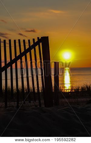 Wooden fence with sunset sky in Cape Cod