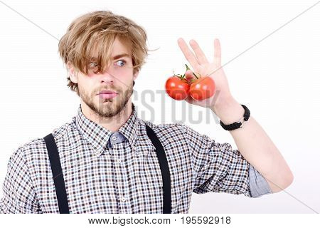 Man With Surprised Or Scared Face And Beard Holds Tomatoes