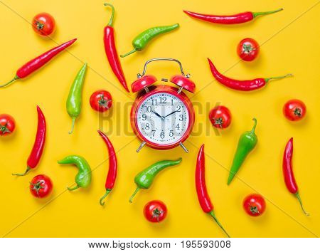 Chili Pepper With Tomatoes And Alarm Clock